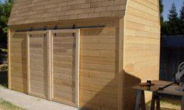 Sliding barn doors from skateboard wheels
