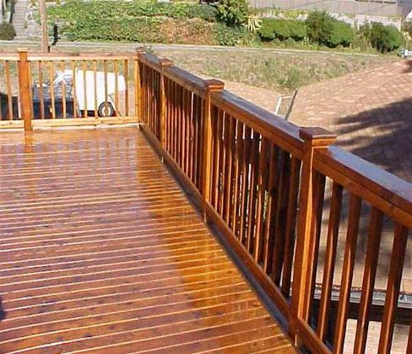 This deck has been stained with a light pigment. The colour will not build up on reapplication.