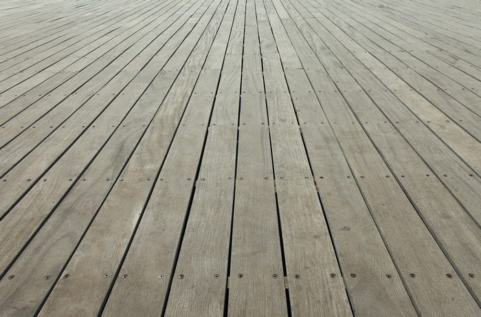Commercial deck cleaners can restore greyed timber to something resembling their original colour.