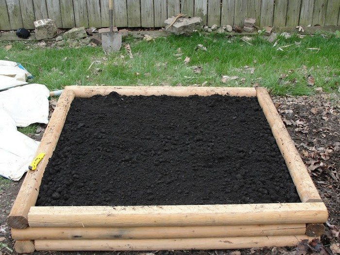 Build a raised garden bed from logs diy projects for - Safest material for raised garden beds ...