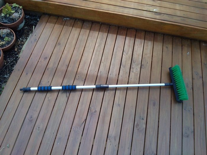 A wet-broom has a hose fitting attachment on the handle so that water flows as you sweep.