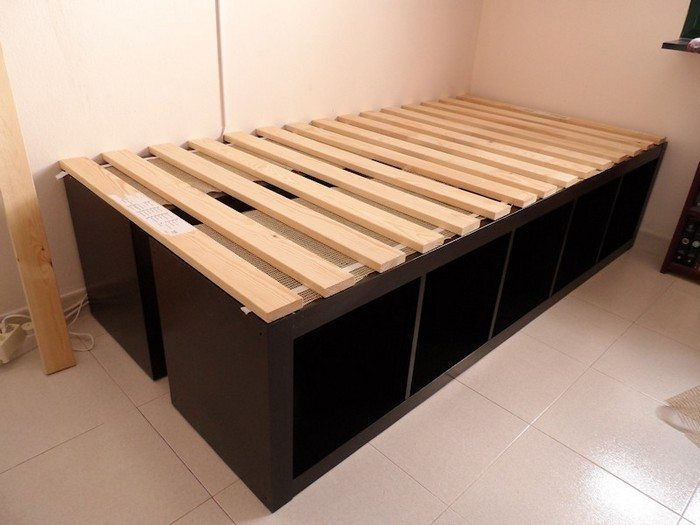Build an inexpensive bed with storage using bookcases ...