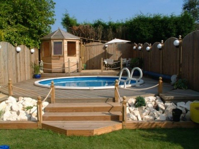 Build an inexpensive above ground swimming pool diy for Above ground pool decks photos