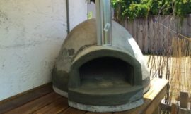 Wood fired pizza oven made with an exercise ball