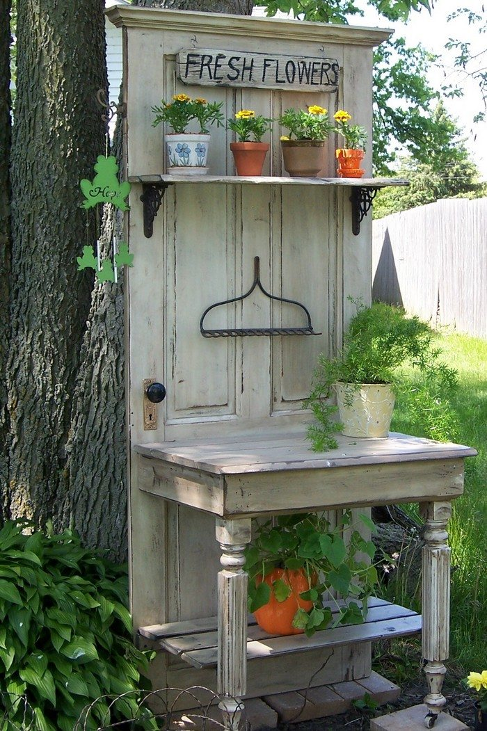 turn an old wood door into a potting bench diy projects for everyone. Black Bedroom Furniture Sets. Home Design Ideas