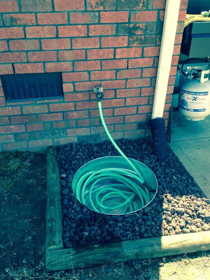 Build a garden hose storage with planter! | DIY projects ...