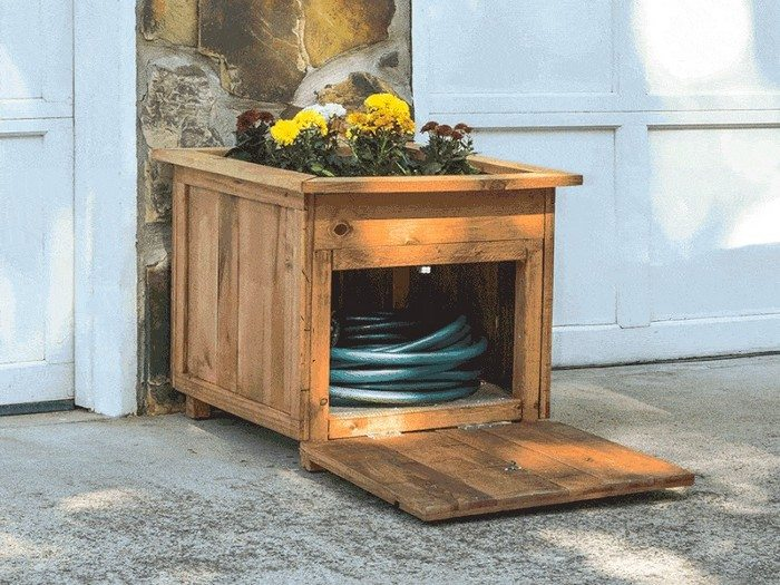 Build a garden hose storage with planter!