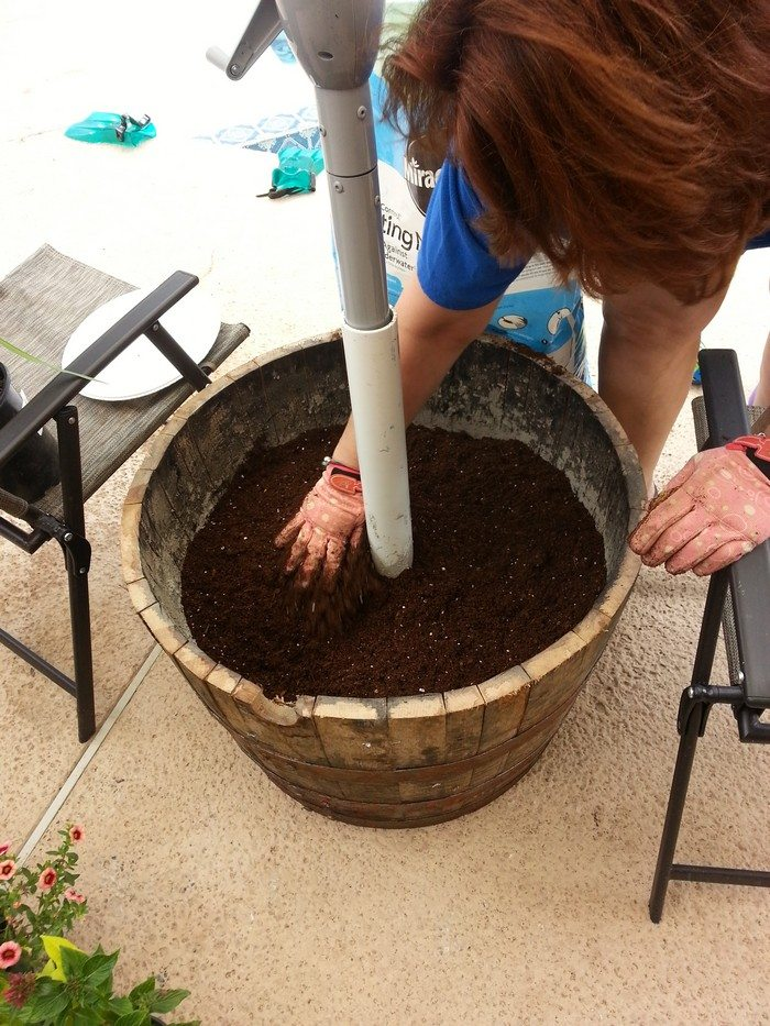 How To Build A Patio Umbrella Stand Planter Diy Projects