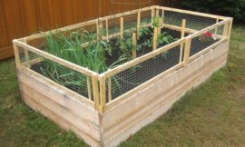Grow and protect your produce with a removable raised garden bed fence