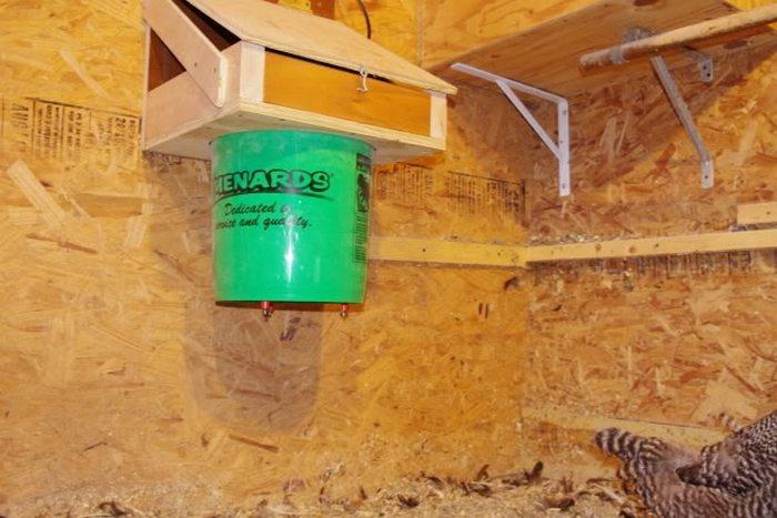 Build a cinder block chicken waterer heater diy for Diy chicken feeder light