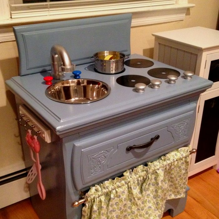 A great example of a DIY play kitchen made from a nightstand