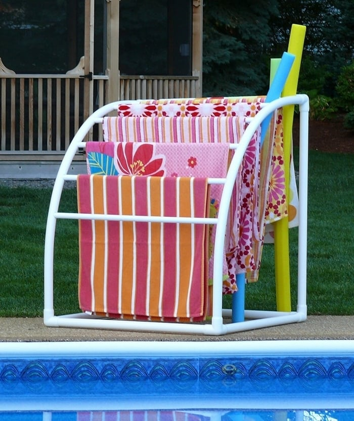 Use a DIY PVC towel rack to hang those beach towels dry!