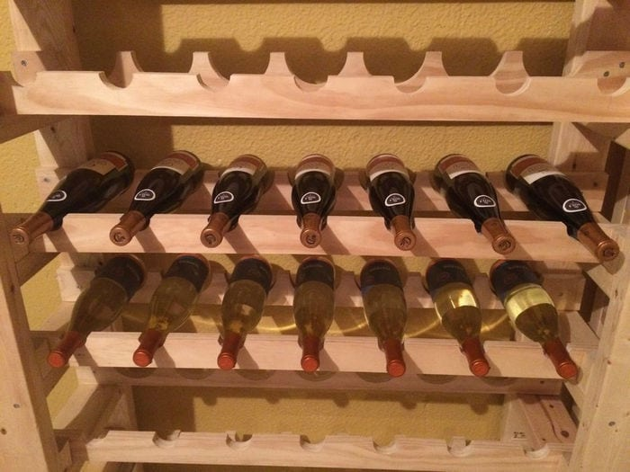 Using a wine rack is a safe and convenient way to store bottles of wine.