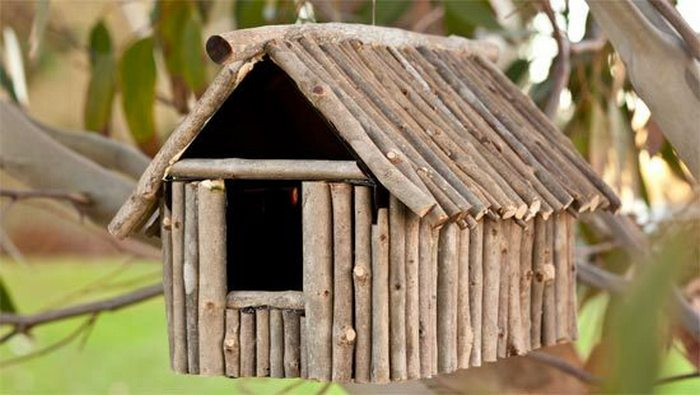 Log cabin birdhouses are beautiful garden additions.