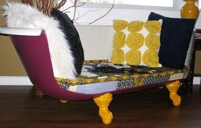 A DIY clawfoot bathtub couch is a great way to bring life to a boring living room.