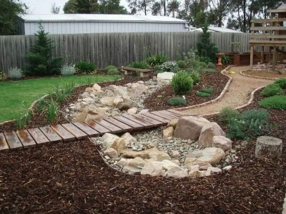 This DIY dry creek bed project is both functional and aesthetically appealing.