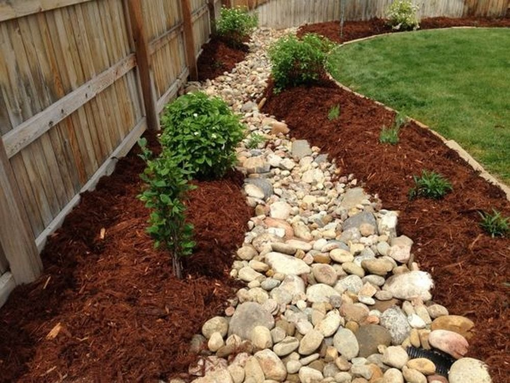 A dry creek bed can help control and re-direct the flow of water.