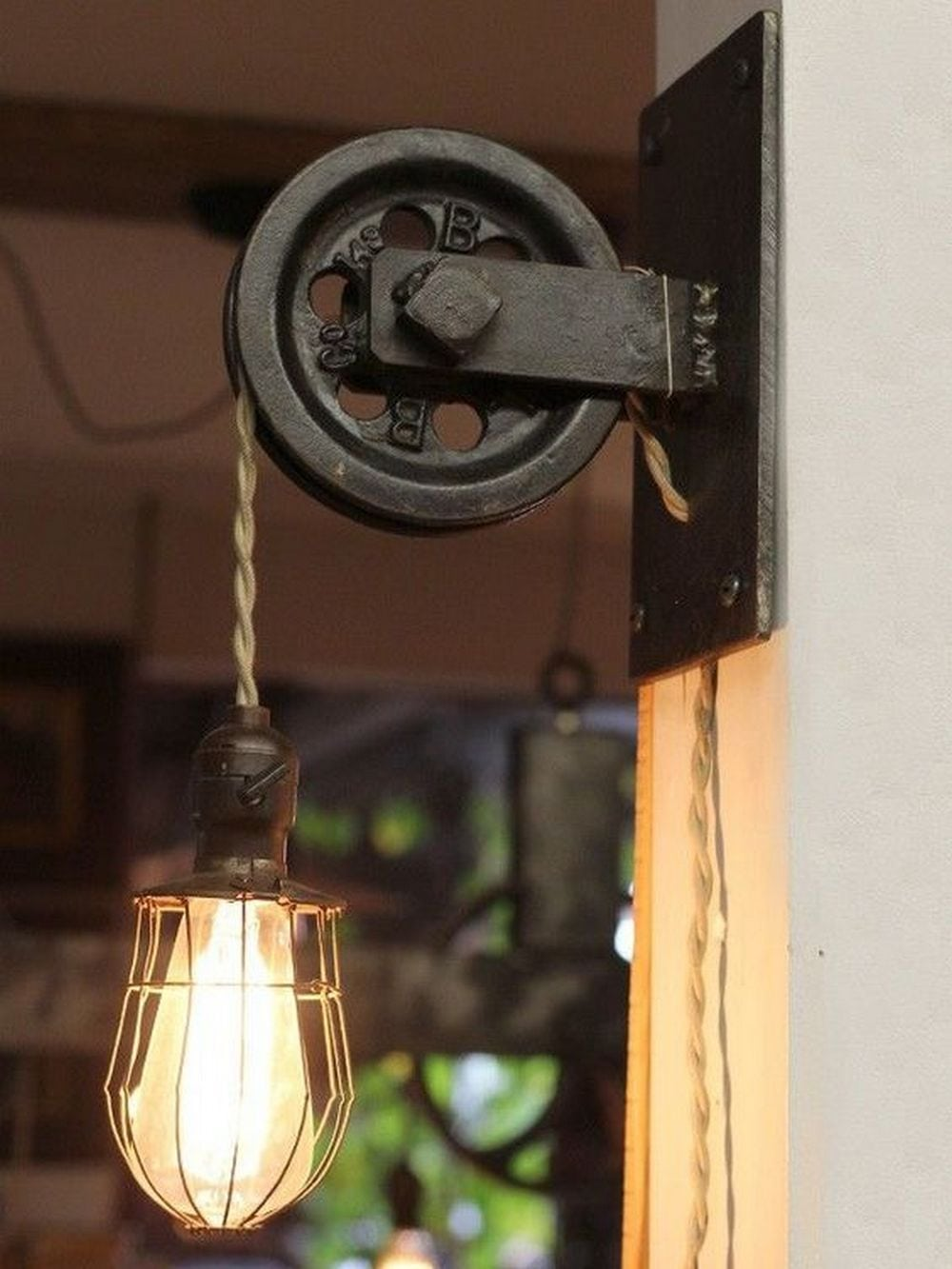 This vintage-style pulley lamp will add character to any room you put it in.