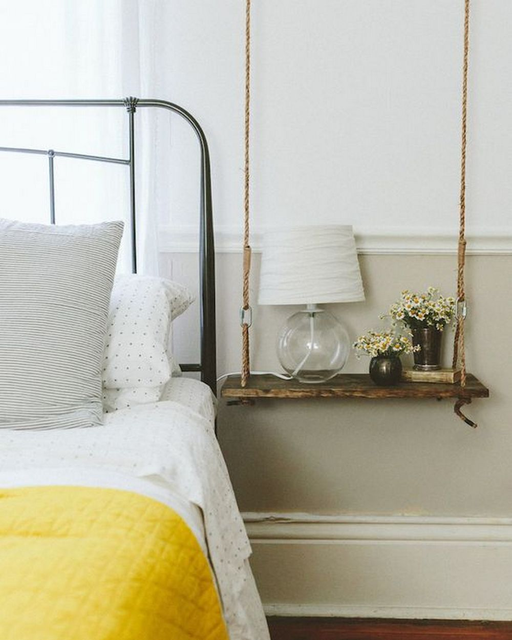 This hanging nightstand is inexpensive, easy to make, and really useful, too!