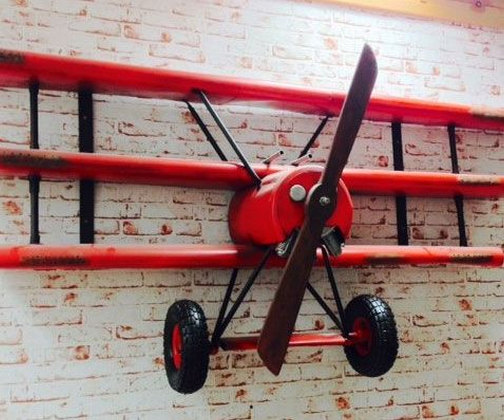 This DIY biplane wall shelf makes a good addition to any room!