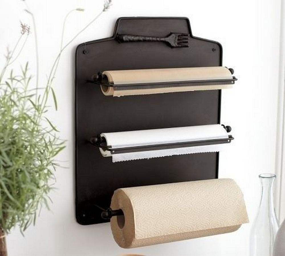 Here's a smart way to organize rolls of paper towel, aluminum foil, and wax paper...