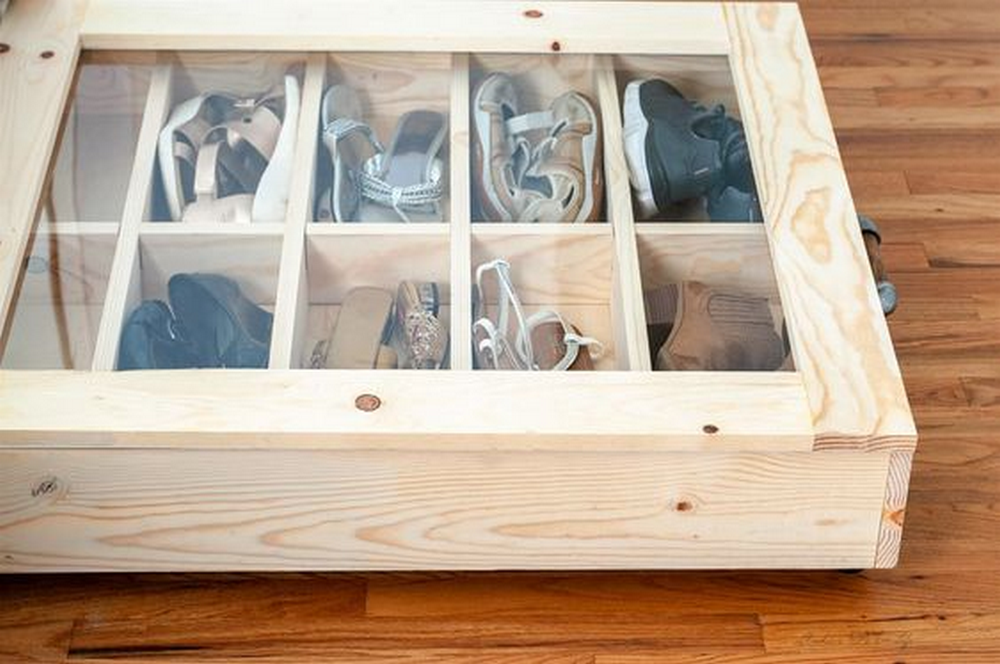Utilizing the area under your bed to organize your shoes will allow you to save space.
